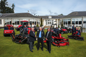 : Scott Fenwick, centre, with Lely UK's account manager Trevor Chard, left, Scott McNeil from Henderson Grass Machinery and the greenkeepers with Toro equipment looking on.