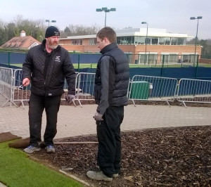 Figure 4 Apprentice, Tom Day, receiving a turfing lesson from Grounds Manager Dave Lawrence.