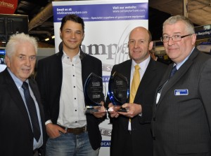 Campey dealers of the year Mark Trubenbacher of Germany (centre left European award) and Sandy Armit of Double A (UK award )with David Briggs (left) and md Richard Campey at BTME DSC 0201
